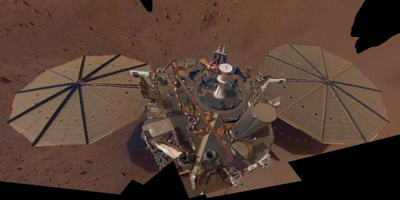 This is NASA InSight's second full selfie on Mars. Since taking its first selfie, the lander has removed its heat probe and seismometer from its deck, placing them on the Martian surface; a thin coating of dust now covers the spacecraft as well.